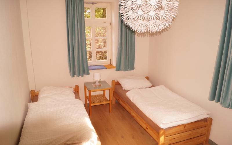 Ferienwohnung im Pfarrhaus Harste - Kleines Schlafzimmer